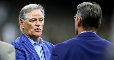 New Orleans Saints general manager Mickey Loomis (left) talks with Minnesota Vikings general manager Rick Spielman before the game against the Minnesota Vikings at the Mercedes-Benz Superdome.
