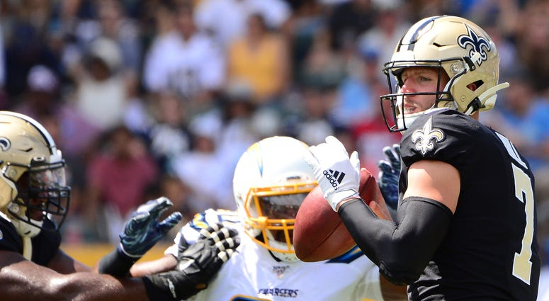 New Orleans Saints quarterback Taysom Hill (7) looks to pass during the second quarter against the Los Angeles Chargers at Dignity Health Sports Park.