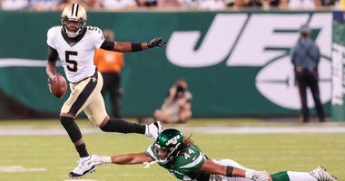 Aug 24, 2019; East Rutherford, NJ, USA; New Orleans Saints quarterback Teddy Bridgewater (5) scrambles for yards as New York Jets linebacker Harvey Langi (44) defends during the first half at MetLife Stadium.