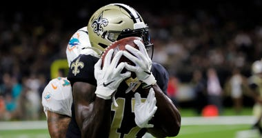New Orleans Saints wide receiver Emmanuel Butler (17) catches a touchdown past Miami Dolphins cornerback Torry McTyer (24) during a preseason game at the Mercedes-Benz Superdome.