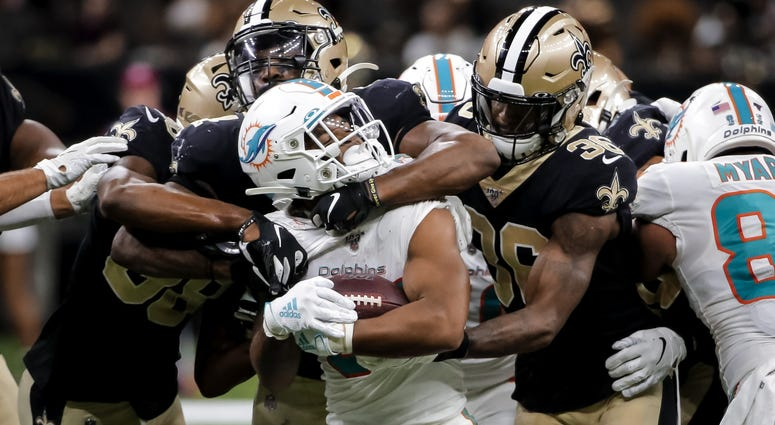 Aug 29, 2019; New Orleans, LA, USA; New Orleans Saints linebacker Darnell Sankey (44) and defensive back T.J. Green (36) tackle Miami Dolphins running back Myles Gaskin (37) during the second half of a preseason game at the Mercedes-Benz Superdome.
