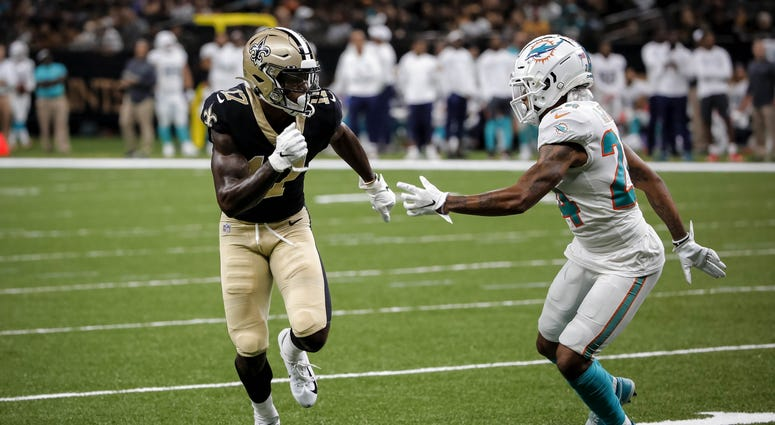 Aug 29, 2019; New Orleans, LA, USA; New Orleans Saints wide receiver Emmanuel Butler (17) runs past Miami Dolphins cornerback Torry McTyer (24) on a touchdown play during a preseason game at the Mercedes-Benz Superdome.