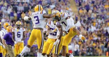 LSU Tigers safety Grant Delpit (7) celebrates with safety JaCoby Stevens (3) during the second quarter against the Georgia Southern Eagles at Tiger Stadium.