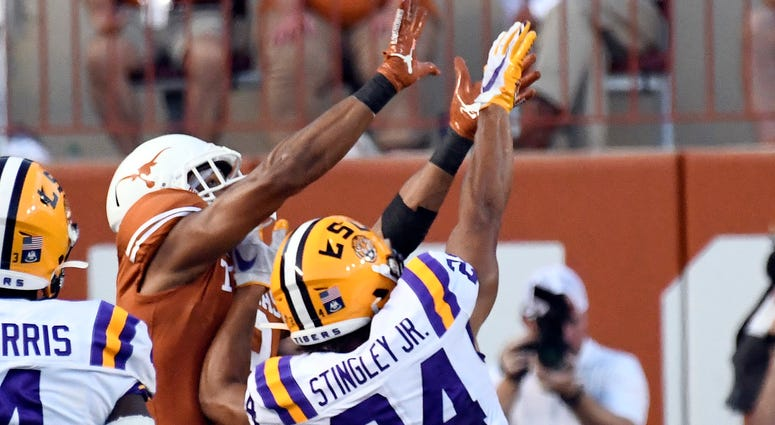Louisiana State Tigers cornerback Derek Stingley Jr. (24) defends a pass intended for Texas Longhorns Collin Johnson (9) at Darrell K Royal-Texas Memorial Stadium.
