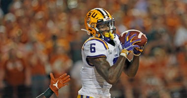 LSU Tigers wide receiver Terrace Marshall Jr. (6) makes a touchdown reception against the Texas Longhorns in the second half at Darrell K Royal-Texas Memorial Stadium.