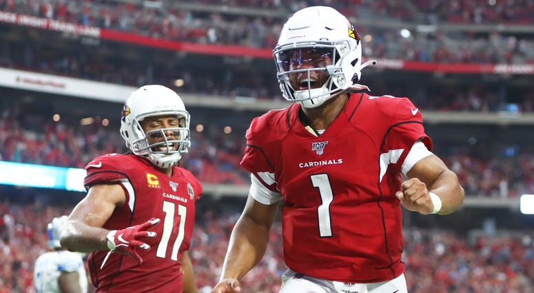 Arizona Cardinals quarterback Kyler Murray (1) and wide receiver Larry Fitzgerald (11) celebrate a game tying two point conversion in the fourth quarter against the Detroit Lions at State Farm Stadium.