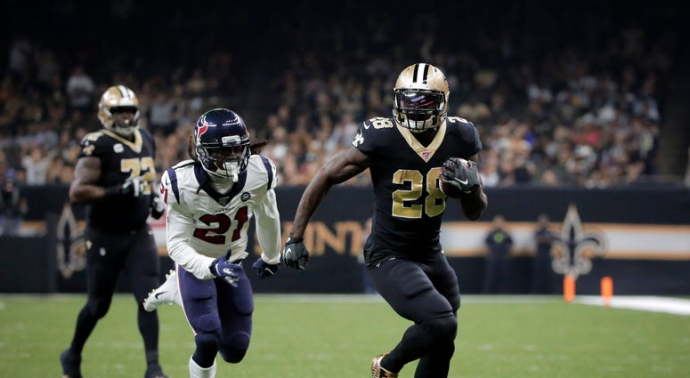 New Orleans Saints running back Latavius Murray (28) runs for a touchdown past Houston Texans cornerback Bradley Roby (21) during the third quarter at the Mercedes-Benz Superdome.