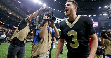 New Orleans Saints kicker Wil Lutz (3) screams as he runs from the field after kicking a game wining field goal against the Houston Texans at the Mercedes-Benz Superdome.