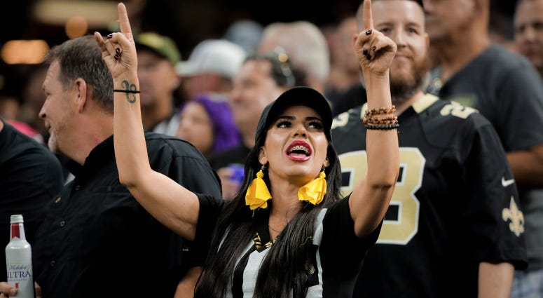 New Orleans Saints fans dress as referees against the Houston Texans for a game at the Mercedes-Benz Superdome.