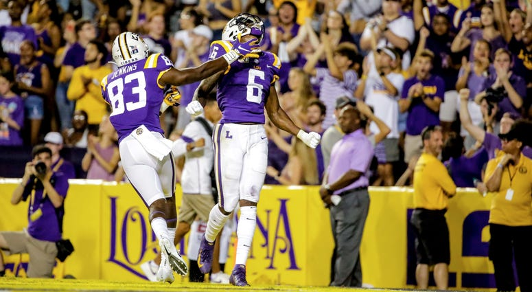 LSU Tigers wide receiver Terrace Marshall Jr. (6) celebrates with wide receiver Jaray Jenkins (83) after a touchdown catch against the Northwestern State Demons during the second quarter at Tiger Stadium.