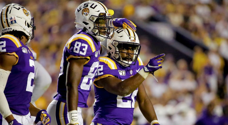 LSU Tigers running back Clyde Edwards-Helaire (22) celebrates with wide receiver Jaray Jenkins (83) during the second quarter against the Northwestern State Demons at Tiger Stadium.