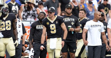 New Orleans Saints quarterback Drew Brees (9) watches game action against the Los Angeles Rams during the first half at Los Angeles Memorial Coliseum.
