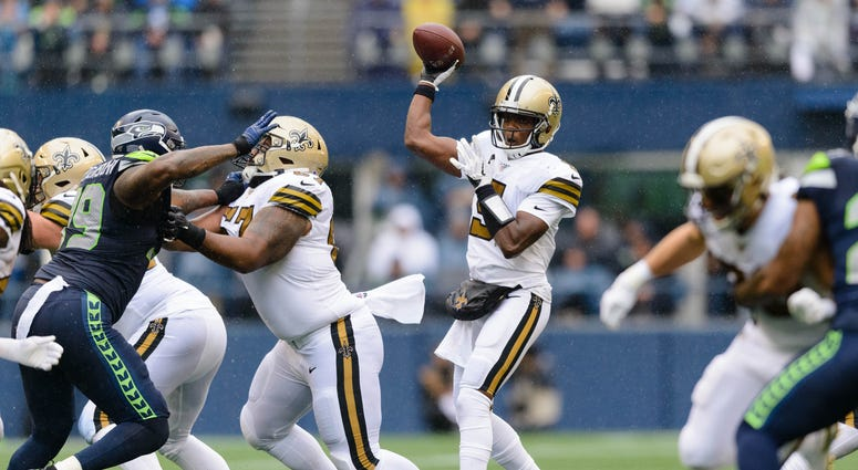 New Orleans Saints quarterback Teddy Bridgewater (5) passes the ball against the Seattle Seahawks during the first half at CenturyLink Field.