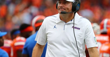 Florida Gators head coach Dan Mullen looks on against the Towson Tigers during the second quarter at Ben Hill Griffin Stadium.
