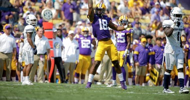 LSU Tigers linebacker K'Lavon Chaisson (18) reacts after a play against the Utah State Aggies during the first half at Tiger Stadium.