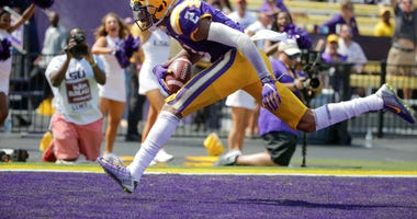 LSU Tigers wide receiver Justin Jefferson (2) catches a touchdown against Utah State Aggies cornerback DJ Williams (not pictured) during the second half at Tiger Stadium.