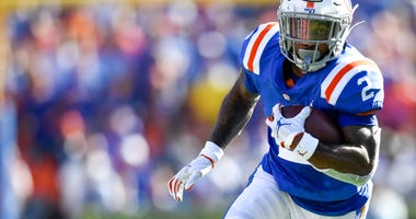 Florida Gators running back Lamical Perine (2) runs the ball during the second quarter against the Auburn Tigers at Ben Hill Griffin Stadium.