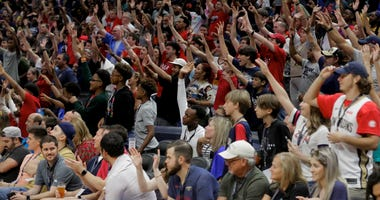 New Orleans Pelicans fans cheer during a open practice at the Smoothie King Center.