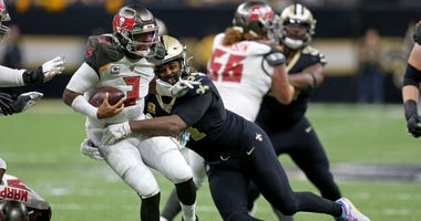 Tampa Bay Buccaneers quarterback Jameis Winston (3) is sacked by New Orleans Saints defensive end Cameron Jordan (94) in the second half at the Mercedes-Benz Superdome.