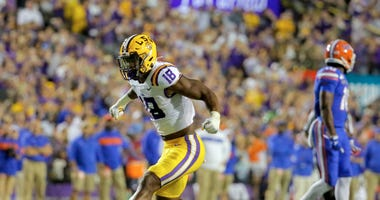 LSU Tigers linebacker K'Lavon Chaisson (18) reacts after a defensive stop against the Florida Gators during the first quarter at Tiger Stadium.