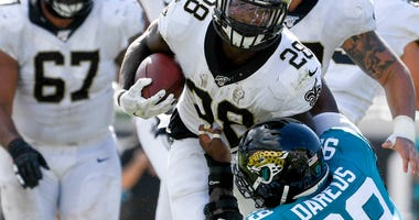 New Orleans Saints running back Latavius Murray (28) runs the ball against Jacksonville Jaguars defensive tackle Marcell Dareus (99) during the fourth quarter at TIAA Bank Field.