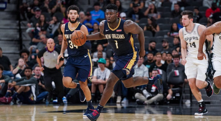 New Orleans Pelicans forward Zion Williamson (1) brings the ball up the court against the San Antonio Spurs at the AT&T Center.