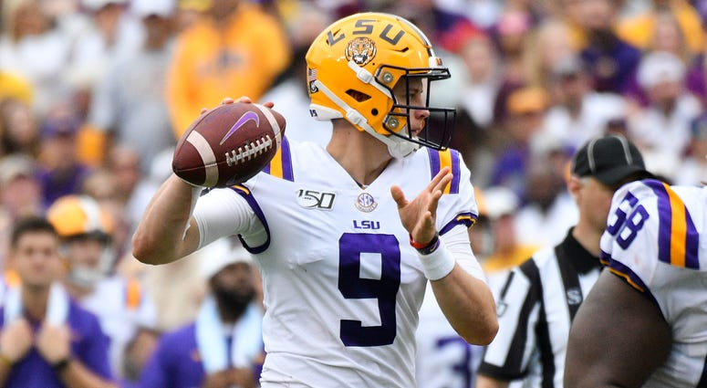 Louisiana State Tigers quarterback Joe Burrow (9) passes against the Mississippi State Bulldogs during the second quarter at Davis Wade Stadium.