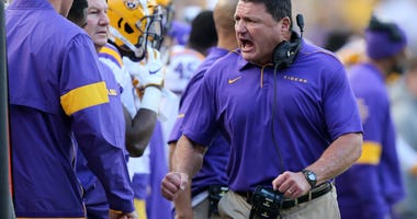 LSU Tigers head coach Ed Orgeron yell on the sidelines in the second half against the Auburn Tigers at Tiger Stadium.