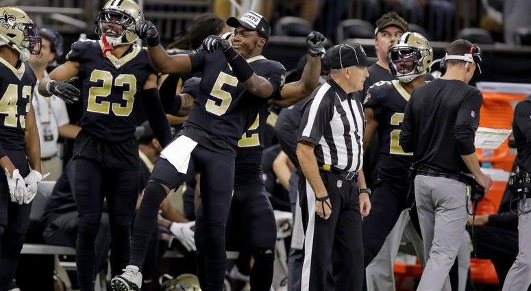 New Orleans Saints quarterback Teddy Bridgewater (5) dances on the sideline after a touchdown by wide receiver Taysom Hill (7) during the fourth quarter at the Mercedes-Benz Superdome.
