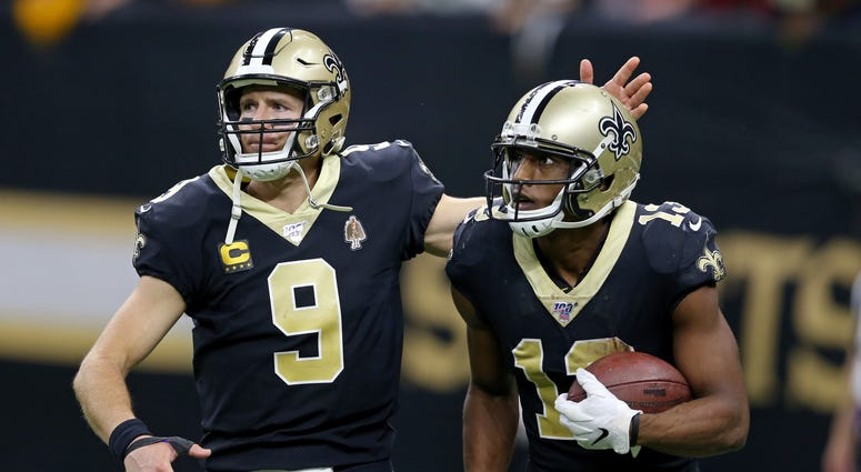 New Orleans Saints wide receiver Michael Thomas (13) celebrates with quarterback Drew Brees (9) after making a fourth quarter touchdown catch against the Arizona Cardinals at the Mercedes-Benz Superdome.