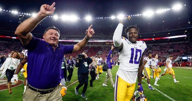LSU Tigers head coach Ed Orgeron and LSU Tigers tight end Stephen Sullivan (10) celebrate as they run off the field after defeating the Alabama Crimson Tide 46-41 during the second half of an NCAA college football game at Bryant-Denny Stadium.