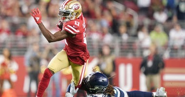 San Francisco 49ers wide receiver Emmanuel Sanders (17) is tackled by Seattle Seahawks cornerback Shaquill Griffin (26) during the first quarter at Levi's Stadium.