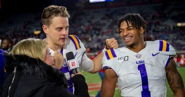 ESPN talks with Louisiana State Tigers quarterback Joe Burrow (9) and wide receiver Ja'Marr Chase (1) after the game against the Mississippi Rebels at Vaught-Hemingway Stadium.
