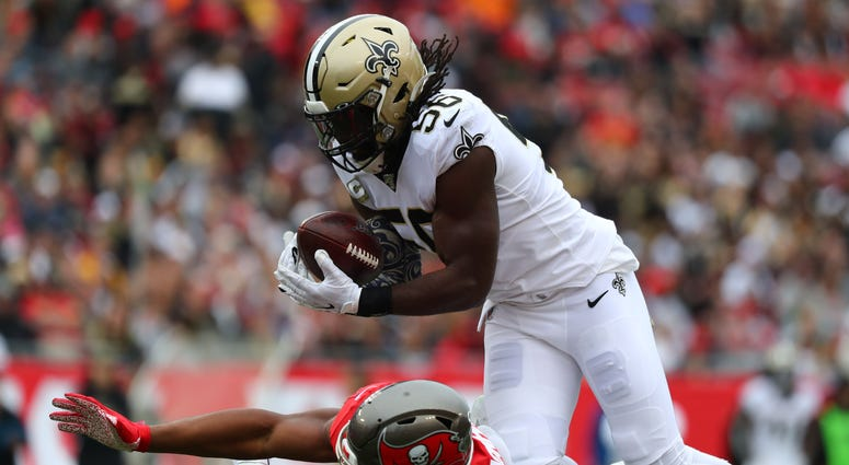 New Orleans Saints outside linebacker Demario Davis (56) intercepts a pass against Tampa Bay Buccaneers tight end O.J. Howard (80) during the first half at Raymond James Stadium.