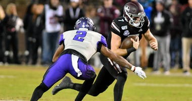 Mississippi State Bulldogs quarterback Tommy Stevens (7) runs the ball against Abilene Christian Wildcats safety Brandon Richmond (2) during the first quarter at Davis Wade Stadium.
