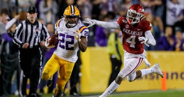 LSU Tigers running back Clyde Edwards-Helaire (22) runs for 89 yards and a touchdown against Arkansas Razorbacks during the second half at Tiger Stadium.