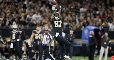 New Orleans Saints tight end Jared Cook (87) makes a catch with Carolina Panthers cornerback Javien Elliott (23) defending in the first quarter at the Mercedes-Benz Superdome. Cook was flagged for offensive pass interference.