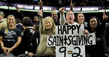 New Orleans Saints fans in the stands celebrate after a win against the Carolina Panthers at the Mercedes-Benz Superdome.