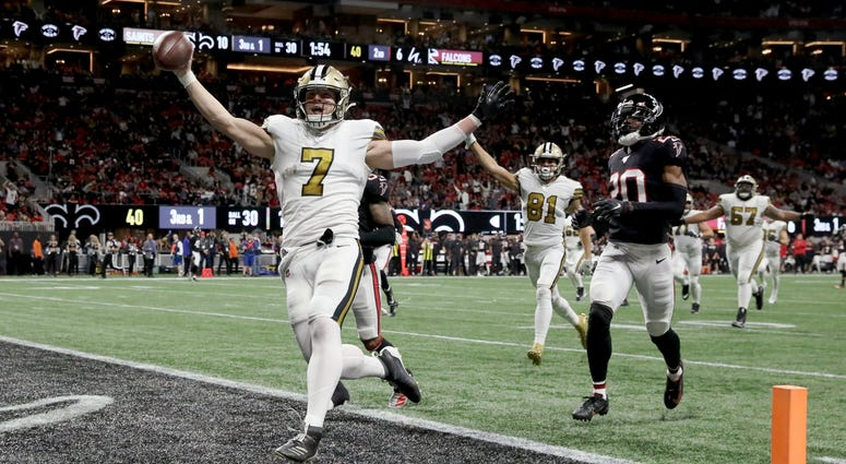 New Orleans Saints quarterback Taysom Hill (7) scores a rushing touchdown in the second quarter against the Atlanta Falcons at Mercedes-Benz Stadium.