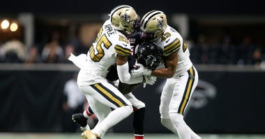 Atlanta Falcons wide receiver Christian Blake (13) is tackled by New Orleans Saints cornerback Eli Apple (25) and free safety Marcus Williams (43) in the second half at Mercedes-Benz Stadium.