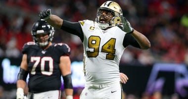 New Orleans Saints defensive end Cameron Jordan (94) shows emotion after a play against the Atlanta Falcons in the second half at Mercedes-Benz Stadium.