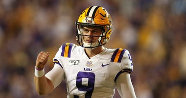 LSU Tigers quarterback Joe Burrow (9) gestures after a touchdown against the Texas A&M Aggies in the second quarter at Tiger Stadium.