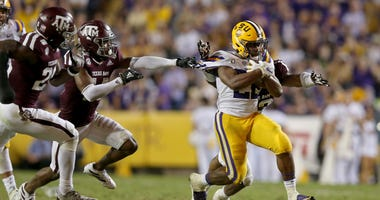 LSU Tigers running back Clyde Edwards-Helaire (22) runs against the Texas A&M Aggies in the second half at Tiger Stadium.