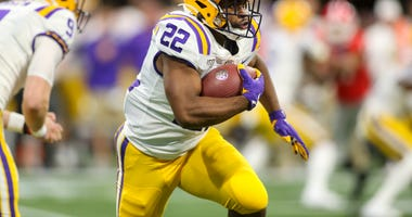 LSU Tigers running back Clyde Edwards-Helaire (22) runs the ball against the Georgia Bulldogs in the first quarter in the 2019 SEC Championship Game at Mercedes-Benz Stadium.