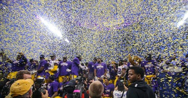 Dec 7, 2019; Atlanta, GA, USA; LSU Tigers players celebrate a victory against the Georgia Bulldogs after the 2019 SEC Championship Game at Mercedes-Benz Stadium.