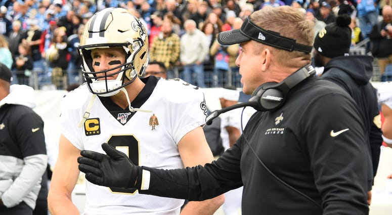 New Orleans Saints quarterback Drew Brees (9) and head coach Sean Payton before the game against the Tennessee Titans at Nissan Stadium.