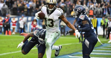 New Orleans Saints wide receiver Michael Thomas (13) breaks the record for receptions in a season with this touchdown reception during the second half against the Tennessee Titans at Nissan Stadium.