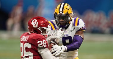 Oklahoma Sooners running back Kennedy Brooks (26) runs the ball against LSU Tigers linebacker Patrick Queen (8) during the second quarter of the 2019 Peach Bowl college football playoff semifinal game.