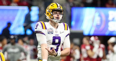 LSU Tigers quarterback Joe Burrow (9) reacts during the second quarter of the 2019 Peach Bowl college football playoff semifinal game against the Oklahoma Sooners at Mercedes-Benz Stadium.