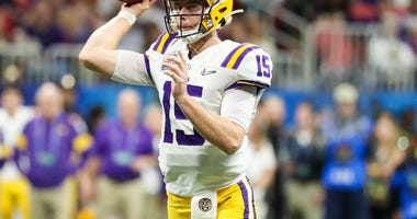 LSU Tigers quarterback Myles Brennan (15) passes the ball during the fourth quarter the 2019 Peach Bowl college football playoff semifinal game between the LSU Tigers and the Oklahoma Sooners at Mercedes-Benz Stadium.